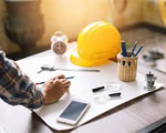 Image of a desk with hardhat and ruler.